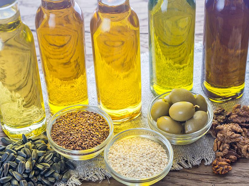 Integriere pflanzliche Öle und Nüsse in deine Sporternährung.